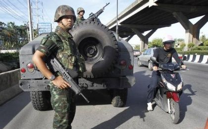 Thai soldiers take up a position on a main road in Bangkok in May. REUTERS/CHAIWAT SUBPRASOM