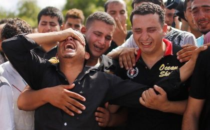 Relatives of civilian victims in Gaza mourn casualties of Israeli airstrikes.