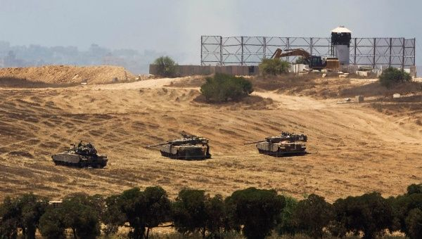 Israeli tanks take position outside Gaza.