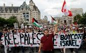 Thousands of people in Ottawa condemn the Israeli atrocities against Gaza. (Photos: Reuters)