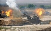 An Israeli mobile artillery unit fires towards the Gaza Strip. (Photo: Reuters)