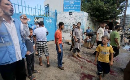 Blood of wounded and dead Palestinians is seen on the ground as people gather following an Israeli air strike, outside a United Nations-run school, where displaced Palestinians take refuge, in Rafah in the southern Gaza Strip August 3, 2014. (Photo: Reuters)