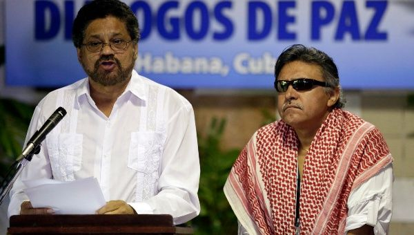 Revolutionary Armed Forces of Colombia (FARC) lead negotiator Ivan Marquez reads from a document next to fellow negotiator Jesus Santrich (R) during a conference in Havana August 12, 2014. (Photo: Reuters)