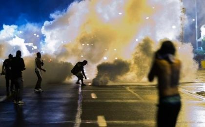 Police in Ferguson used excessive force against protesters. (Photo: AFP)