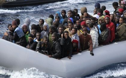 Migrants sit in a boat off the coast of Sicily in an Italian naval rescue operation (Photo: Reuters)