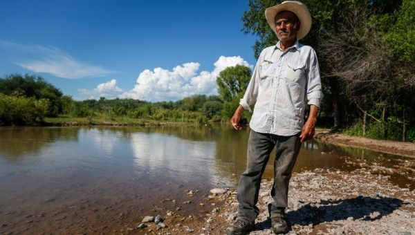 A local farmer stands besides the Sonora River, which was contaminated in August by the Buenavista Copper mine (Photo: Clayton Conn)