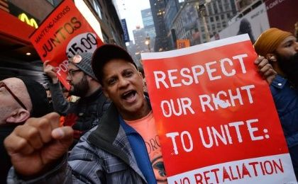 Demonstrators protest outside a McDonald's restaurant near New York Times Square as part of a nationwide protest of fast-food workers. (Photo: AFP)