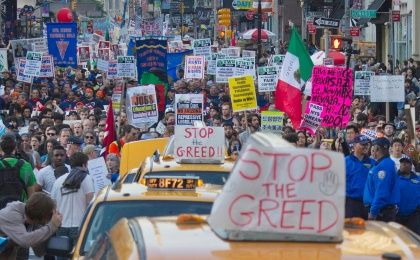 Thousands of demonstrators, including Occupy Wall Street activists, participate in the May Day march through downtown Manhattan, New York. (Photo:Reuters)
