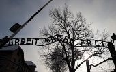 "A sign reading ""Arbeit macht frei"" (Work makes you free) is seen in January 2014 at the main gate of Auschwitz during ceremonies marking the 69th anniversary of the concentration camp's liberation and commemorating victims of the Holocaust. (Photo: Reuters/Kacp Pempel)"