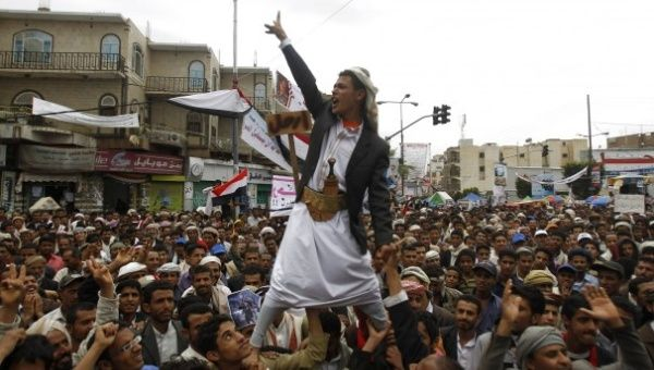an_anti-government_protester_is_carried_by_fellow_protesters_as_he_shouts_slogans_during_a_rally_to_demand_the_ouster_of_yemenxs_president_ali_abdullah_saleh_outside_sanaa_university..jpg_1718483346.jpg