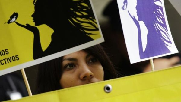 An Amnesty International activist in Mexico demonstrates for women's rights in El Salvador (Photo: Reuters/Henry Romero)