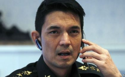 Winthai Suvaree, a spokesman for the Thai military government's NCPO, speaks on his mobile phone during an interview with Reuters at the Royal Army headquarters in Bangkok, Sept. 11, 2014. (Photo: Reuters)