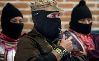 The leader of the Zapatista National Liberation Army (EZLN), Subcomandante Marcos (C) smokes a pipe during opening of the forum to mark the fifteenth anniversary of the Zapatista uprising in San Critobal de las Casas in Mexico's state of Chiapas, January 2, 2009. (Photo: Reuters/Jorge Dan Lopez)