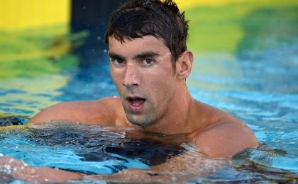 Michael Phelps reacts after placing seventh in the 100m freestyle in the 2014 USA National Championships, August 6, 2014 (Photo: Reuters)