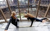 Visitors stand on the new glass floor at the Eiffel Tower in Paris October 6, 2014 (Photo: Reuters)