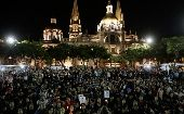 People gather outside Guadalajara Cathedral in support of the Ayotzinapa Teacher Training College missing students. Thousands marched across Mexico on Wednesday to demand the government find out what happened to dozens of missing students. The students from a teachers' college went missing after they clashed with police in Iguala on September 26 (Photo: Reuters).