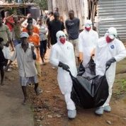 Health workers remove the body of Prince Nyentee, a 29-year-old man whom local residents said died of Ebola virus in Monrovia September 11, 2014. (Photo: Reuters)