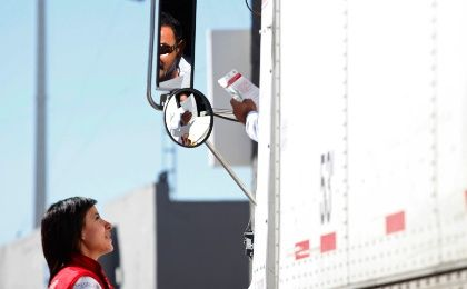 A woman from Mexico's Secretariat of Health talks to a truck driver explaining the symptoms of Ebola with the help of a leaflet, at the border crossing between Mexico and the U.S. in Ciudad Juarez October 15, 2014. Leaflets and signs explaining the symptoms of Ebola and asking passengers to seek medical assistance if they happen to show any, were placed at all border crossings, bus terminals and the airport in Ciudad Juarez, according to local media. (Photo: Reuters/Jose Luis Gonzalez)