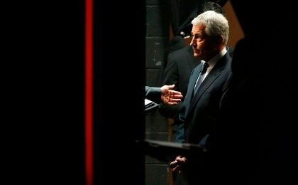 U.S. Secretary of Defense Chuck Hagel stands backstage as he arrives to participate in the Washington Ideas Forum, in Washington October 29, 2014 (Photo: Reuters)