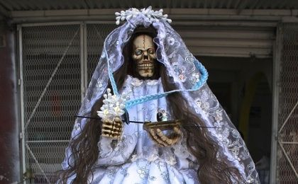Santa Muerte, the skeletal saint, is usually dressed in a white wedding gown (Photo: Kimberley Brown)
