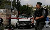 An Israeli border police officer walks in front of  the vehicle of a Palestinian motorist who rammed into pedestrians, near the scene of an attack in Jerusalem November 5, 2014. The man rammed his car into pedestrians in central Jerusalem on Wednesday in the second attack of its kind in two weeks, killing one person and fueling concerns of another Palestinian uprising. (Photo: Reuters/Ammar Awad)