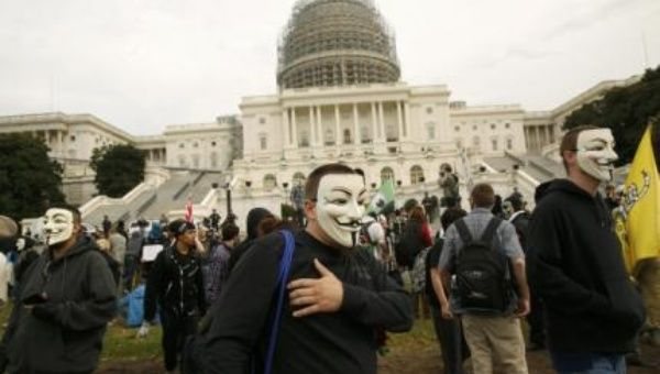 Members and supporters wearing Guy Fawkes masks of the Anonymous movement depart the U.S. Capitol in Washington November 5, 2014. (Photo: Reuters