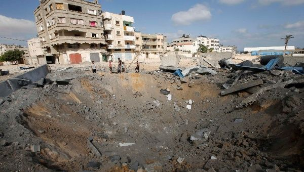 Crater caused by an israeli air srtike in gaza photo reuters