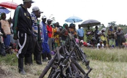 Militants from the Democratic Forces for the Liberation of Rwanda (FDLR) stand near a pile of weapons after their surrender in Kateku, a small town in eastern region of the Democratic Republic of Congo (DRC), May 30, 2014. (Photo: Reuters/Kenny Katombe)
