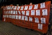 Protesters in Mexico City with photos of the 43 missing students. (Photo: AFP)