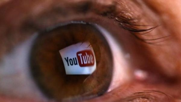 A picture shows the logo of YouTube reflected in the eye of a person in the town of Zenica, Bosnia. (Photo: Reuters)