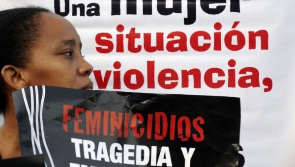 Woman protesting against feminicide (Photo: Reuters).