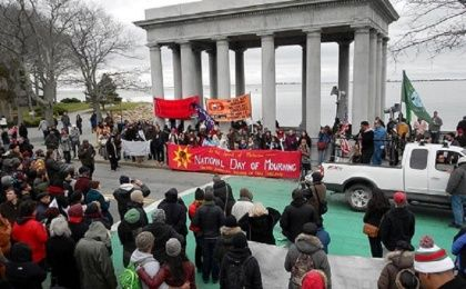 Members and supporters of the United American Indians of New England gather around Plymouth Rock to honor the National Day of Mourning event they have organized for the last 45 years. (Photo: Liza Green)
