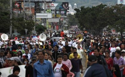 People take part in a peace march against drug and gang violence in Tegucigalpa November 29, 2014. The impoverished Central American nation has the highest homicide rate in the world, with 90.4 murders per 100,000 inhabitants, almost twice that of nearby countries with high crime, such as Venezuela and El Salvador. (Photo: Reuters/Jorge Cabrera)