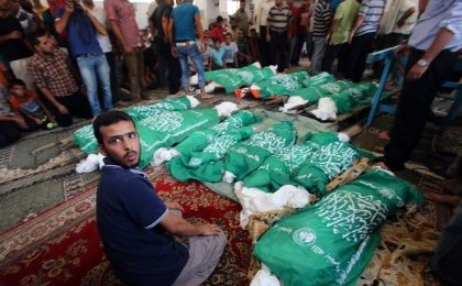 Bodies of Abu Jama's family, who medics said were killed in an Israeli air strike that destroyed their house in Gaza on July 20, 2014.