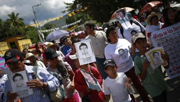 People hold pictures of missing students during a demonstration on the outskirts of Chilpancingo, in the Mexican state of Guerrero (Photo: REUTERS)