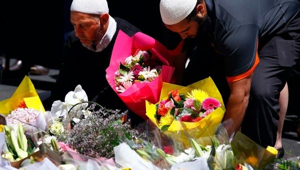 Members of the Australian Muslim community place floral tributes among thousands of others near the cafe where hostages were held for over 16 hours. Sydney, Dec. 16, 2014