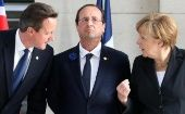 (L-R) Britain's Prime Minister David Cameron, France's President Francois Hollande and Germany's Chancellor Angela Merkel attend a ''Last Post'' ceremony at the Menin Gate in Ypres, June 26, 2014, to commemorate the centenary of the start of World War I. (Photo: Reuters/Francois Lenoir)