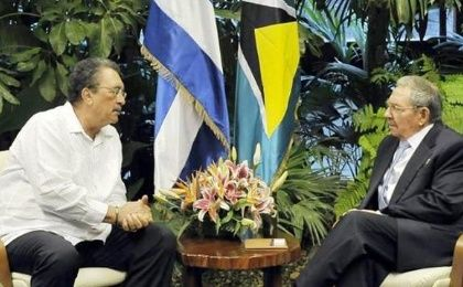 Saint Lucia's Prime Minister Dr. Kenny Anthony meets with Cuban President Raul Castro at the recent Cuba-CARICOM Summit