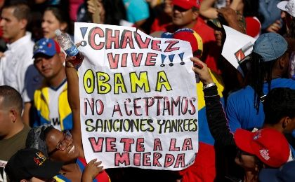 Supporters of Venezuela's Bolivarian Revolution hold a banner during a rally rejecting US sanctions in Caracas December 15, 2014.