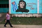 A man walks past near an image of revolutionary hero Ernesto
