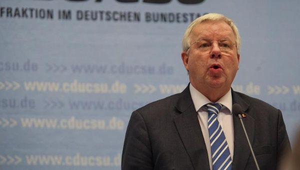 Michael Fuchs is also the deputy parliamentary floor leader of Angela Merkel's Christian Democrats.