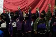 Zapatistas raise their fists during 20th anniversary celebrations of the armed indigenous insurgency in Oventic, 2013.