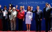 (L-R) Bolivia's President Evo Morales, Uruguay's President Jose Mujica, Brazil's President Dilma Rousseff, Argentina's President Cristina Fernandez de Kirchner, Paraguay's President Horacio Cartes and Venezuela's President Nicolas Maduro wave while posing for photographs during the Southern Common Market (MERCOSUR) trade bloc annual presidential summit.