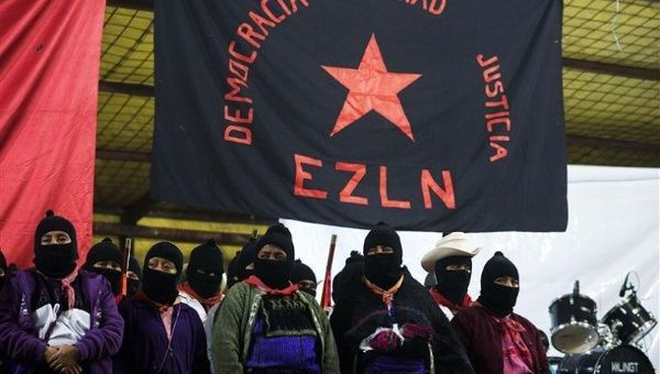 Zapatistas stand under the Zapatista flag during 20th anniversary celebrations of the armed indigenous insurgency in Oventic December 31, 2013.