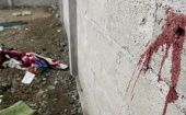Blood is seen on the wall of a building in the Tlatlaya community after 22 people, alleged members of the Drug Cartel, were killed in a confrontation with soldiers of the Mexican Army, June 30, 2014 in Tlatlaya, Mexico.