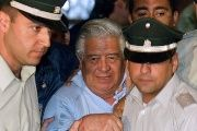 Twenty-three former secret police agents in Chile were sentenced to prison terms, among them General Manuel Contreras, who ran the country's secret police.
