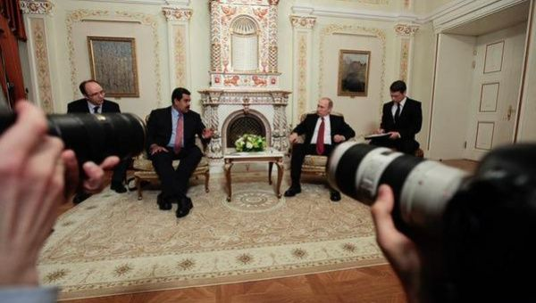 Maduro and Putin meet in Moscow to discuss oil.