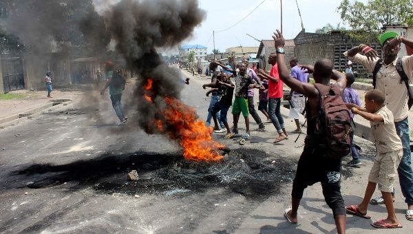 Demonstrators burn tyres to set up barricades during a protest in the Democratic Republic of Congo