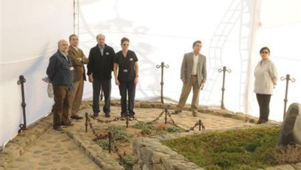 Chilean Forensic Service officials inspect the tomb of Chilean poet Pablo Neruda, inside the grounds of his house-museum April 7, 2013