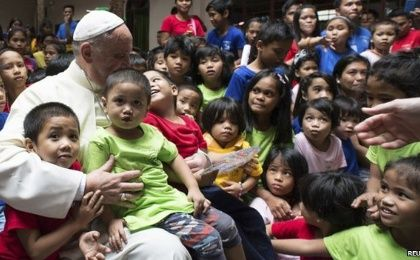Pope Francis meets with children during his recent trip to the Philippines.